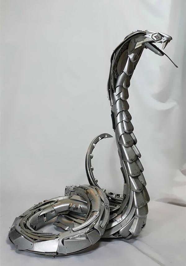 Niesamowite rzeźby zwierząt z kołpaków 11